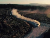 landscape image of forest rally course in wales with dust flying