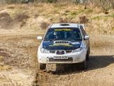 white subaru impreza on gravel stage rally course in wales
