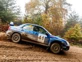 blue subaru impreza hand brake turn on forest rally driving course