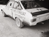 Black and white picture of ford escort MK2 rally stage car with forest experience rally school
